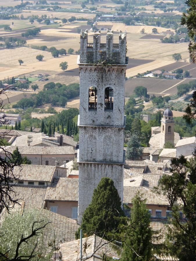 Amazing view from the hill to the old tower of the medieval town of Assisi. Italy, August 2012 stock images
