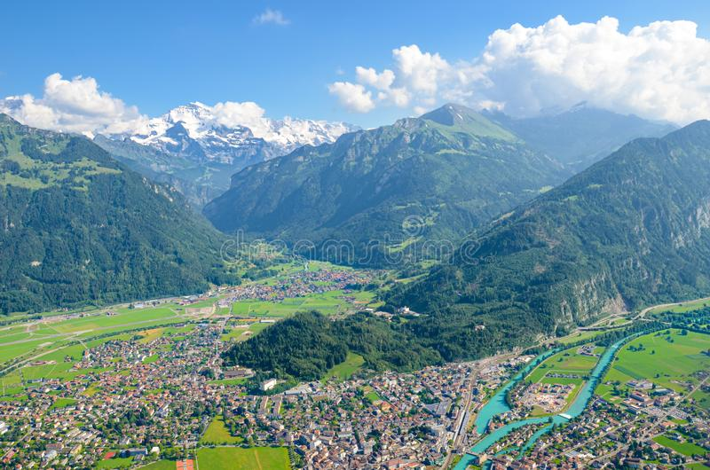 Amazing view of Interlaken and adjacent mountains photographed from the top of Harder Kulm, Switzerland. Swiss Alps. Beautiful stock photo