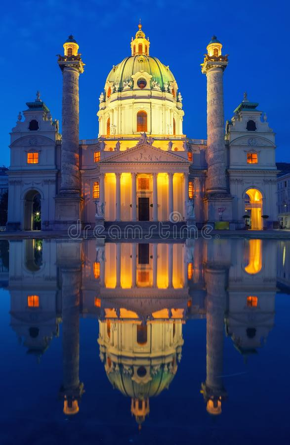 Amazing view of Karlskirche with illumination and reflection in the water, Vienna, Austria. Amazing view of Karlskirche or St. Charles's Church - one of famous royalty free stock image