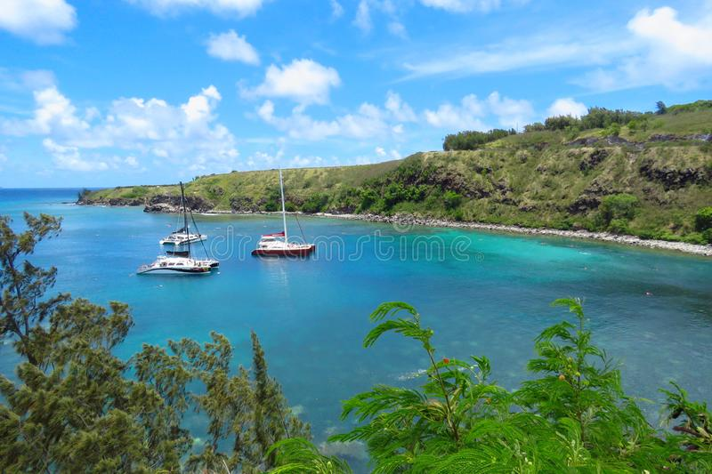 Panoramic view over Honolua Bay, Maui, Hawaii. Amazing view over Honolua Bay where sail boats are moored and tourists snorkel to discover the colourful royalty free stock photo