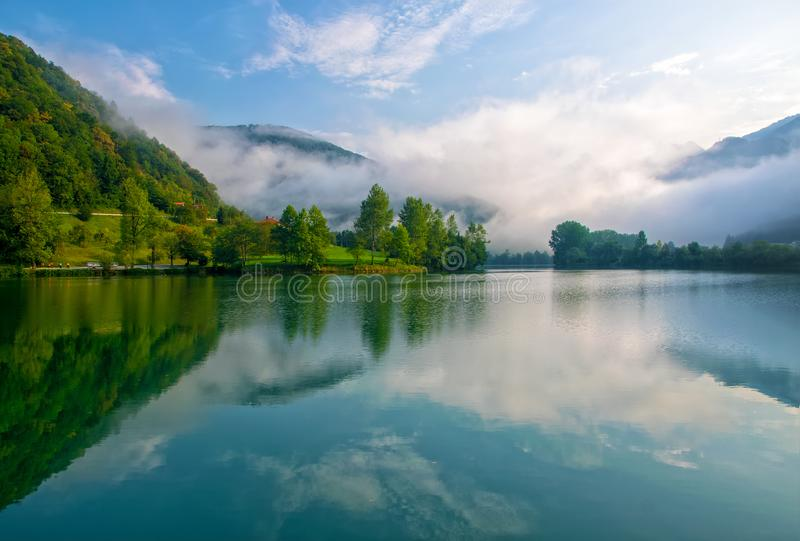 Amazing view of reservoir on Soca river near Most na Soci, Slovenia at foggy morning royalty free stock photography