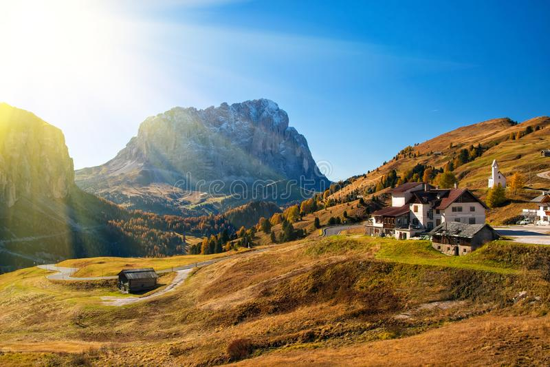 Amazing autumn view on Sassolungo mountain and Gardena Pass. Dolomite Alps, South Tyrol, Italy. Amazing view on Sassolungo - Langkofel - mountain and Gardena stock image
