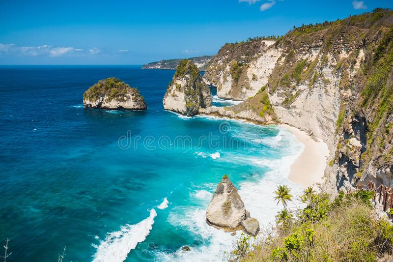 Amazing view of a secret beach with coconut palms and rocks in Nusa Penida, Bali. Amazing view of a secret beach with coconut palms and rocks in Nusa Penida stock photo