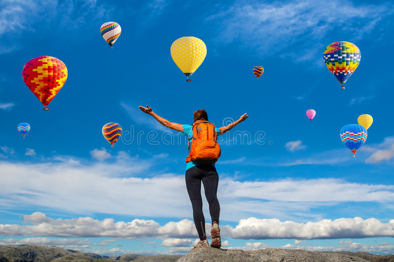 Amazing view with sport girl and a lot of hot air balloons. Artistic picture. Beauty world. The feeling of complete freedom stock photography