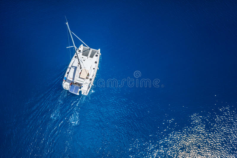 Amazing view to Catamaran cruising in open sea at windy day. Drone view - birds eye angle.  royalty free stock photo