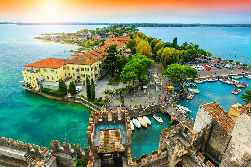Spectacular panorama from the tower Scaliger, Sirmione, Garda lake, Italy. Amazing view to the old bridge and harbor of Sirmione, from the Scaliger castle with royalty free stock image