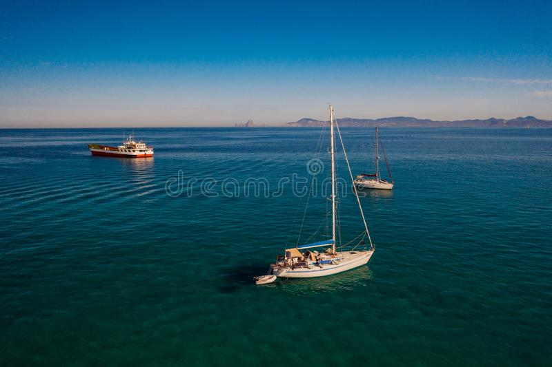 Amazing view to Yacht sailing in open sea at windy day. stock photos