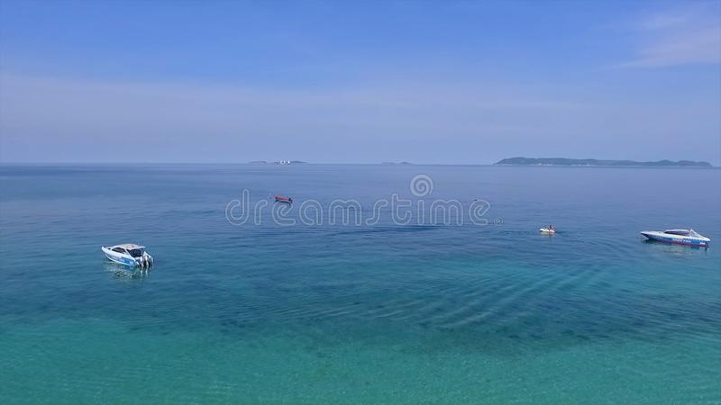 Amazing view to Yacht sailing in open sea at windy day. Drone view - birds eye angle , Little paradise island,Thailand. Beautiful crystal clear sea at tropical royalty free stock images