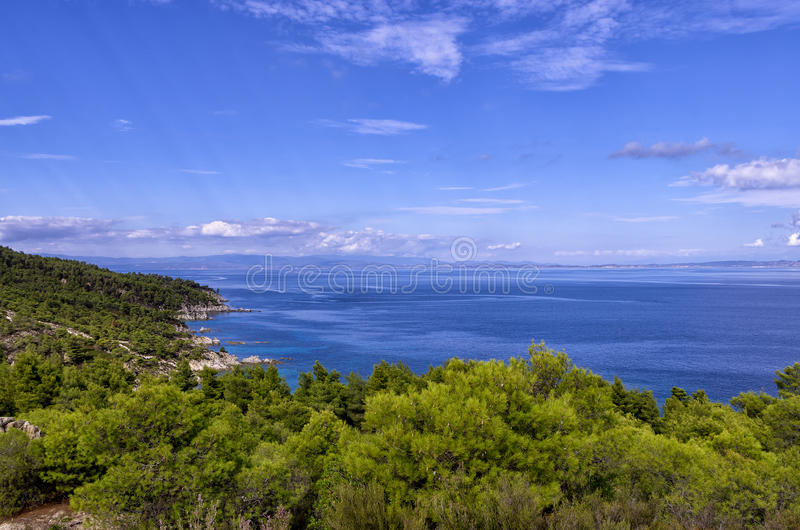 Amazing view from the top of a mountain down to the sea in Chalkidiki, Greece royalty free stock photo