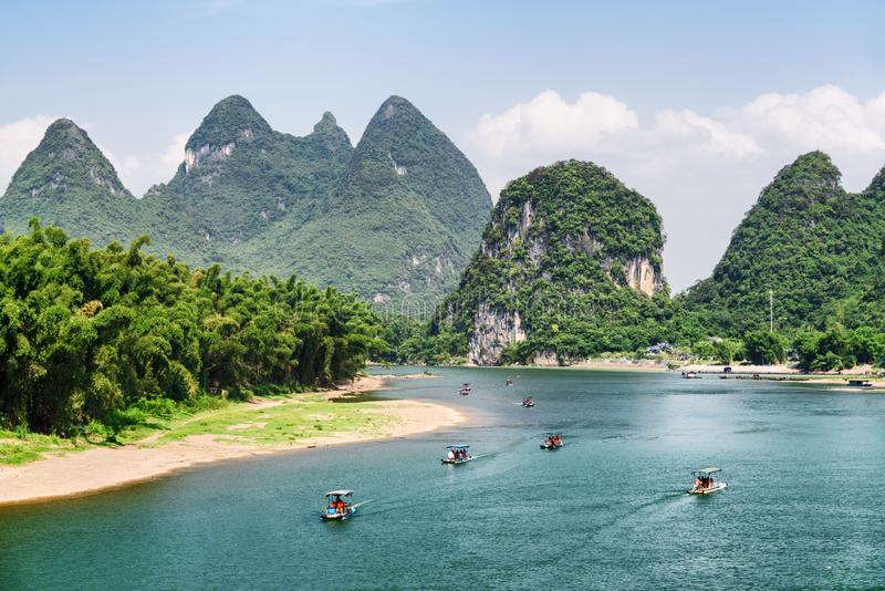 Amazing view of tourist motorized rafts on the Li River. (Lijiang River) with azure water among scenic karst mountains at Yangshuo County of Guilin, China stock image