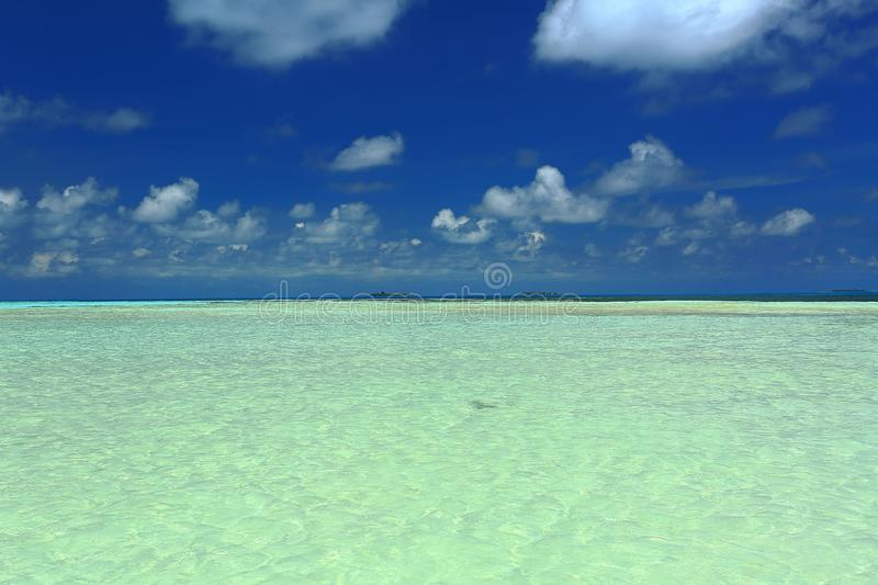 Amazing view of turquoise water of Indian Ocean and blue sky with white clouds. Maldives. Beautiful nature background stock photo