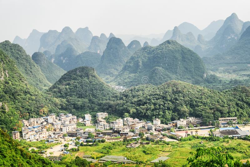 Amazing view of valley among scenic karst mountains, Yangshuo. Amazing view of valley among scenic karst mountains at Yangshuo County of Guilin, China. Wonderful stock photos