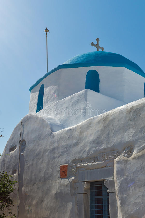 Amazing view of White chuch with blue roof in town of Parakia, Paros island, Greece. Amazing view of White chuch with blue roof in town of Parakia, Paros island royalty free stock photography