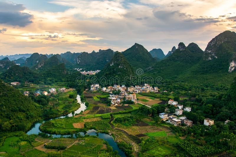 Amazing view of Yangshuo rice fields and rocks in China. Amazing landscape of Yangshuo rice fields and rocks in China aerial view royalty free stock images
