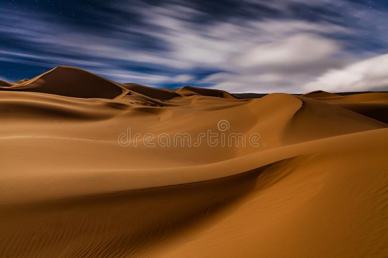 Amazing views of the Sahara desert under the night starry sky. Amazing views of the Sahara desert under the night starry sky royalty free stock photos