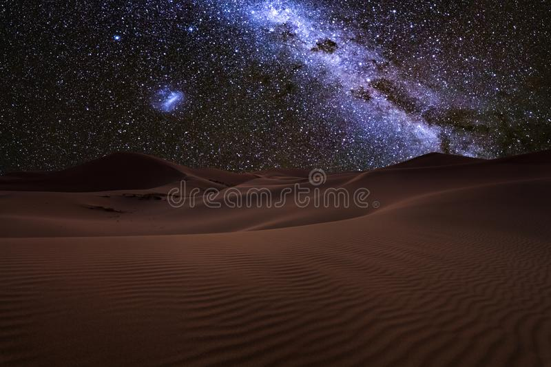 Amazing views of the Sahara desert under the night starry sky. royalty free stock photos