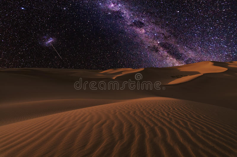 Amazing views of the Sahara desert under the night starry sky. stock photos