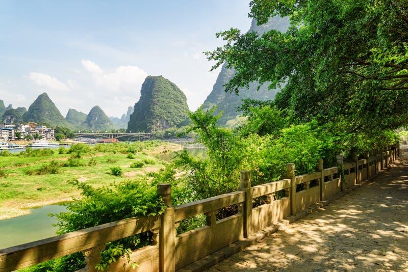 Amazing walkway among green trees along the Li River, Yangshuo. Amazing walkway among green trees along the Li River (Lijiang River) at Yangshuo County of Guilin stock image