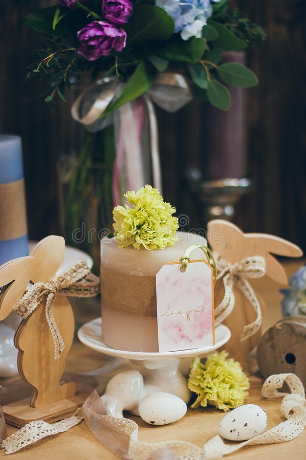 An amazing wedding bouquet in blue violet tones with the candles beautiful rustic wood vintage decoration for event stock image