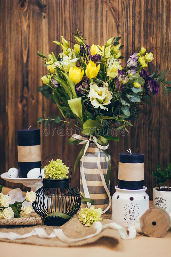 An amazing wedding bouquet in yellow violet tones with the black candles beautiful rustic wood vintage decoration for event stock photography