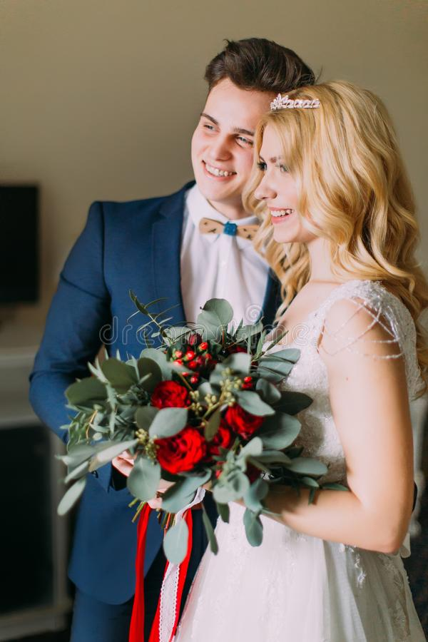 Amazing wedding couple softly smiling. Wedding day stock photo