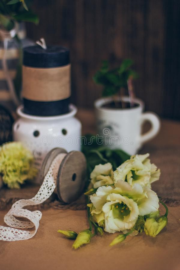 An amazing wedding decoration in yellow green tones with the black candles beautiful rustic wood vintage style for the event stock photo