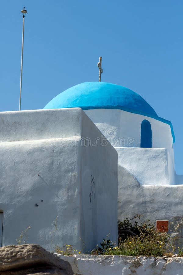 Amazing White chuch with blue roof in town of Parakia, Paros island, Greece. Amazing White chuch with blue roof in town of Parakia, Paros island, Cyclades stock image