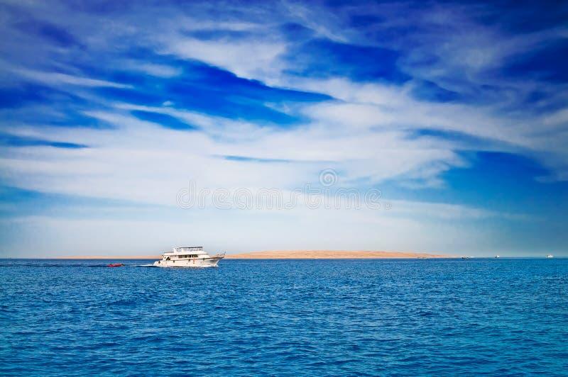 Amazing white yacht next to desert. stock images