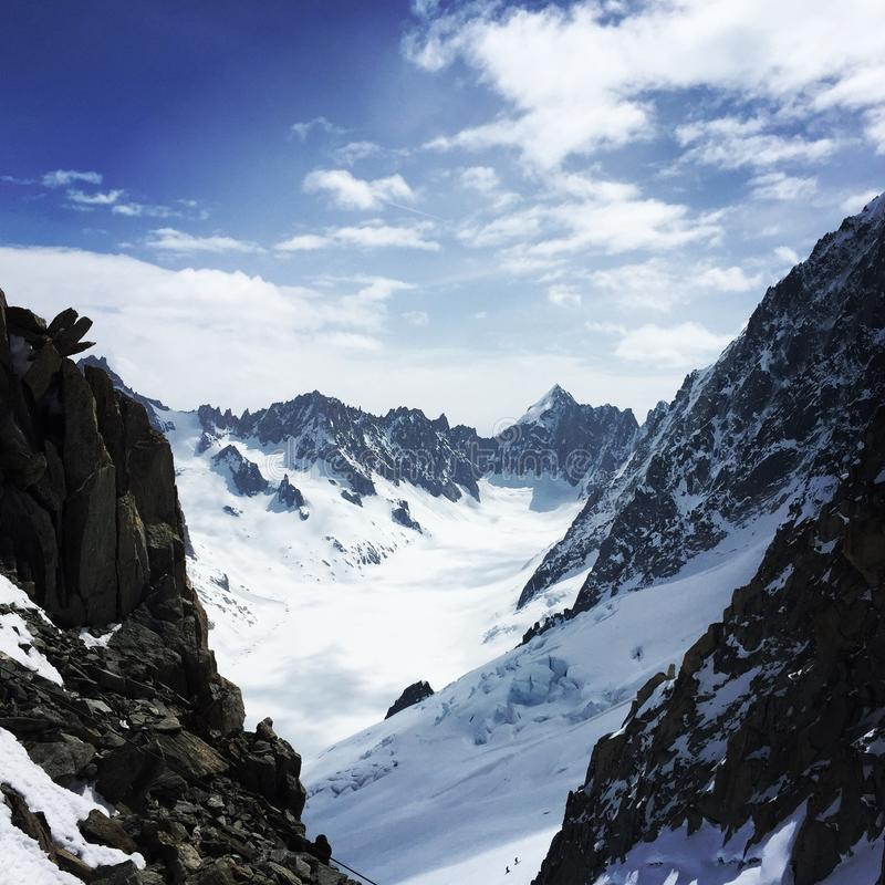 High wiew from a glacier in frot of the MONT BLANC. Amazing wiew in the valley near the Mont Blanc, and handsome cloudy sky stock images