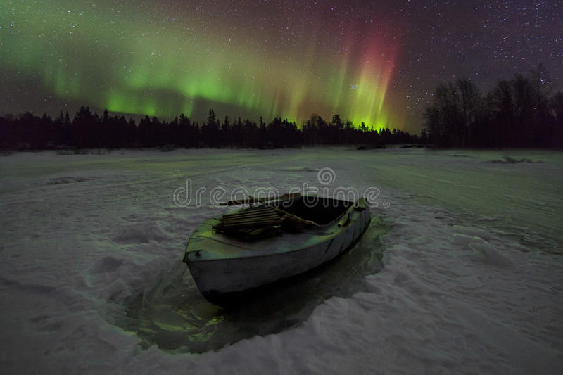 Amazing winter landscape with northern lights royalty free stock photography