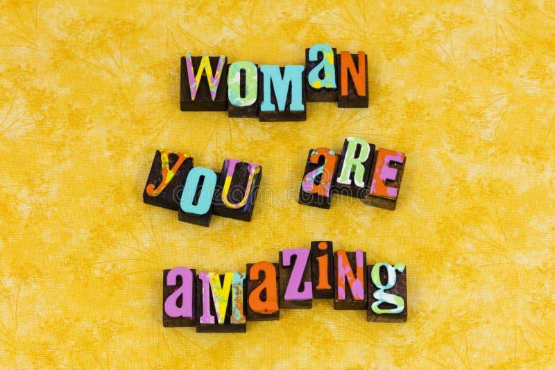 Amazing woman feminism feminist female. Amazing woman women gender girl power intelligent beautiful leader leadership letterpress typography message feminism stock photos