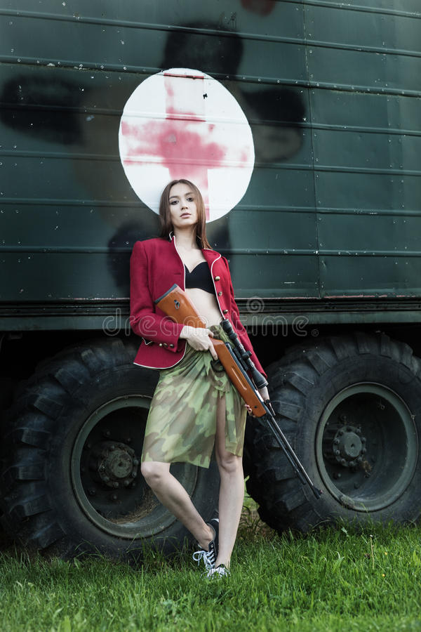 Amazing women with the gun. Amazing woman with the gun stock photography