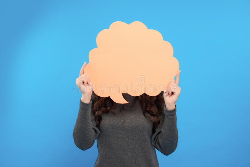 Amazing young woman showing sign speech bubble banner looking happy excited.  royalty free stock photo
