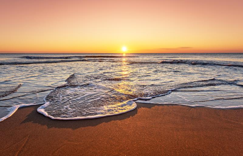 Amazingly colorful sea beach sunset. Golden sands stock photography