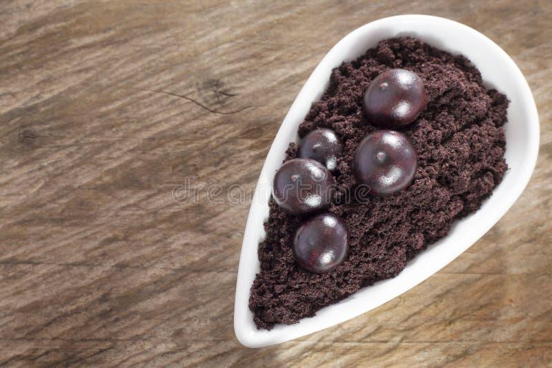 The amazon acai fruit Euterpe oleracea. The acai is a fruit of characteristic very dark purple color stock photo