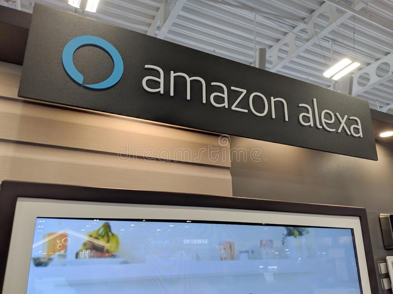 Amazon Alexa sign which is a Smart Assistant on a wall display. Honolulu -  March 16, 2019:  Amazon Alexa sign which is a Smart Assistant on a wall display in stock photography