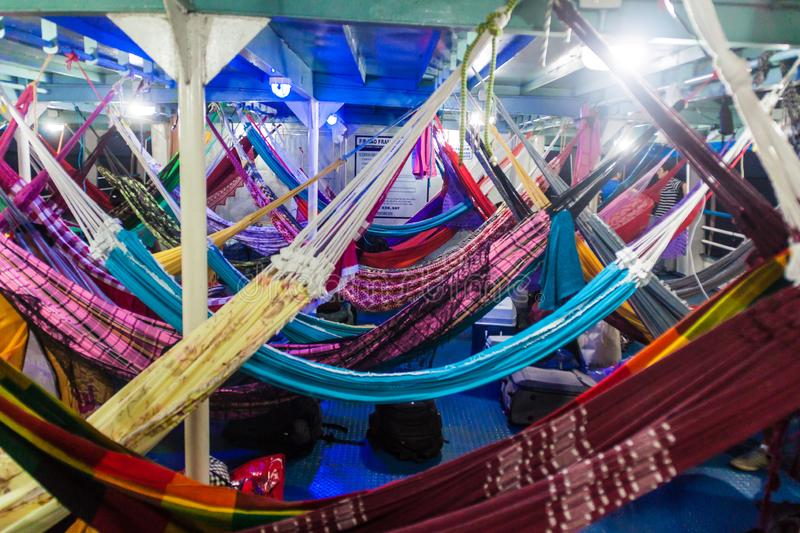 AMAZON, BRAZIL - JUNE 29, 2015: Hammock deck at a river boat which plies river Amazon between Santarem and Macapa, Braz royalty free stock images