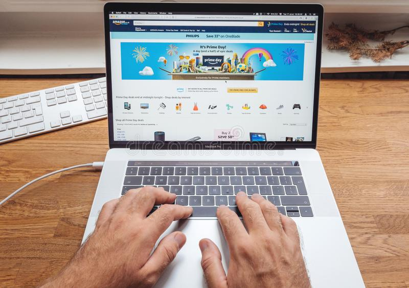 Amazon.co.uk Prime day man shopping on computer for diverse goods stock photo