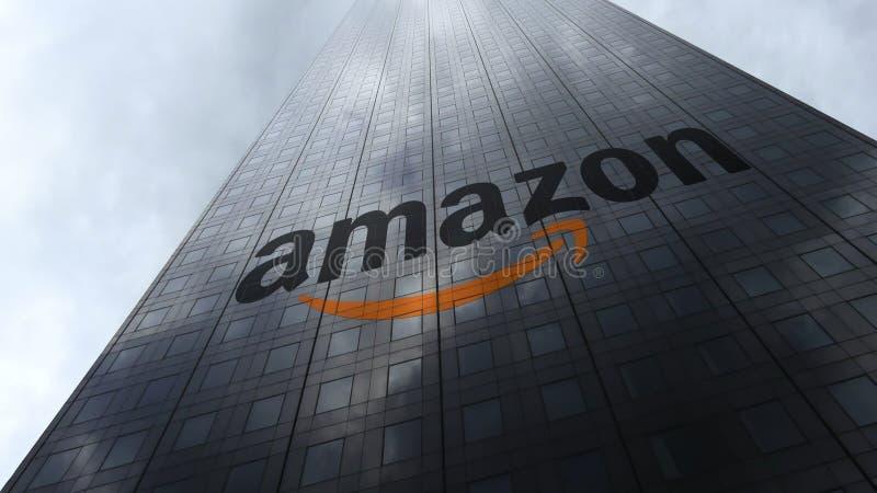 Amazon.com logo on a skyscraper facade reflecting clouds. Editorial 3D rendering stock image