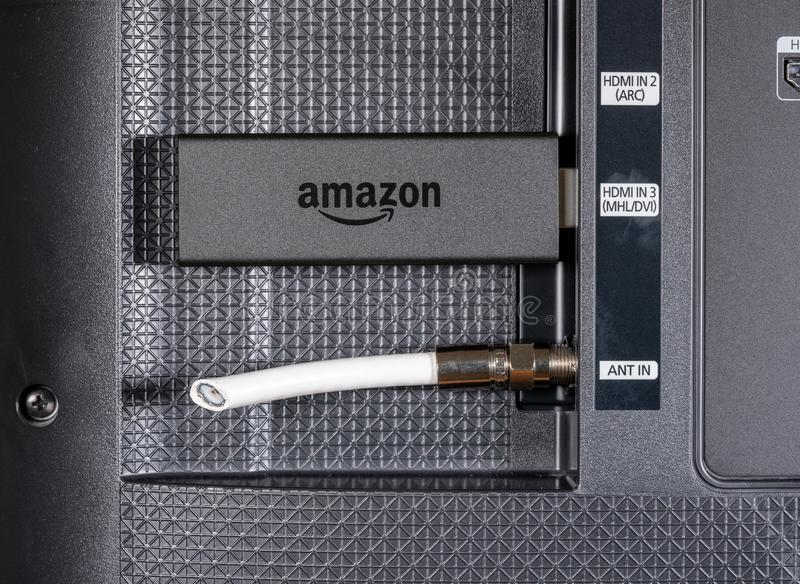 Amazon Fire TV streaming stick by cut antenna cord. MORGANTOWN, WV - 20 JUNE 2018: Amazon Fire TV streaming stick alongside cut cable connection royalty free stock photography