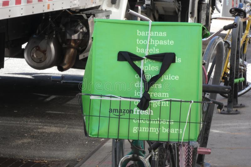 Amazon Fresh. An Amazon Fresh container on a bike in Union Square, New York City. Amazon Fresh is a grocery delivery service that belongs to Amazon stock photo