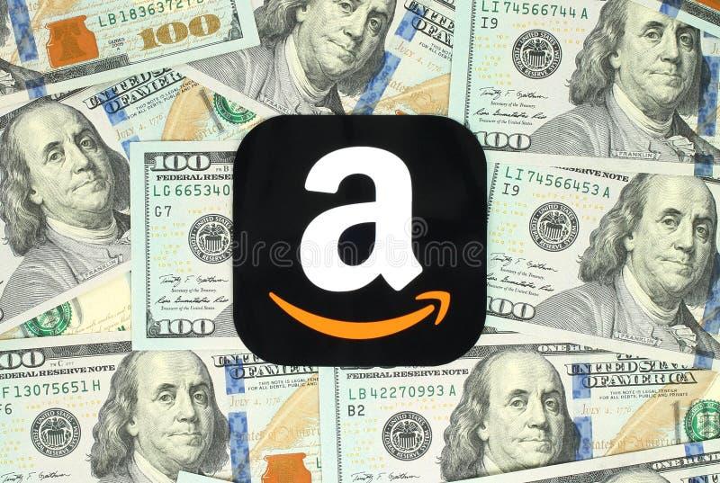 Amazon icon printed on paper and placed on money background. Kiev, Ukraine - June 13, 2016: Amazon icon printed on paper and placed on money background. Amazon