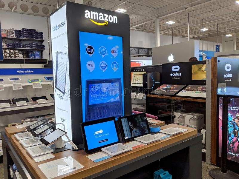 Amazon Kindles, Echo Show, and Tablets on display in Honolulu Best Buy store. Honolulu - March 16, 2019: Amazon Kindles, Echo Show, and Tablets on display in stock images