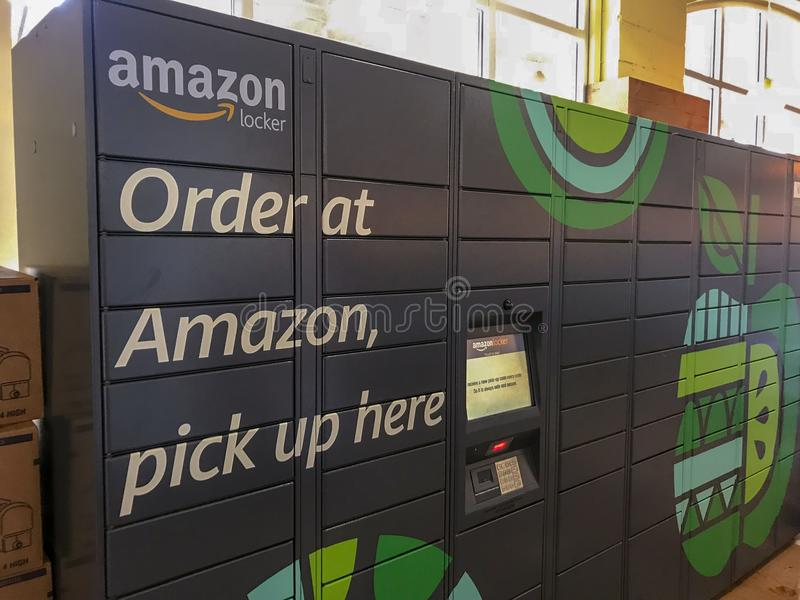 Amazon Locker sitting inside a Whole Foods location in Washington, DC. WASHINGTON, DC JULY 10, 2018: Amazon Locker sitting inside a Whole Foods location in stock images