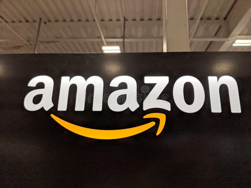 Amazon logo on black shiny wall in Honolulu Best Buy store. Honolulu -  March 16, 2019:  Amazon logo on black shiny wall in Honolulu Best Buy store.  Amazon is royalty free stock images