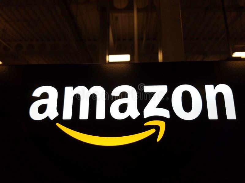 Amazon logo on black shiny wall in Honolulu. HONOLULU - JANUARY 12, 2017: Amazon logo on black shiny wall in Honolulu Best Buy store on January 12, 2017. Amazon stock photo