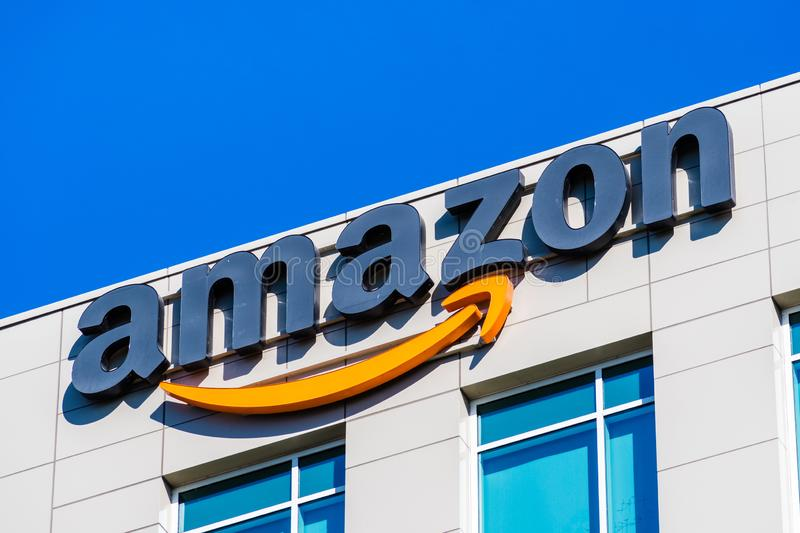 Amazon logo displayed at the Company`s HQ. November 2, 2018 Sunnyvale / CA / USA - Amazon logo on the facade of one of their office buildings located in Silicon stock images