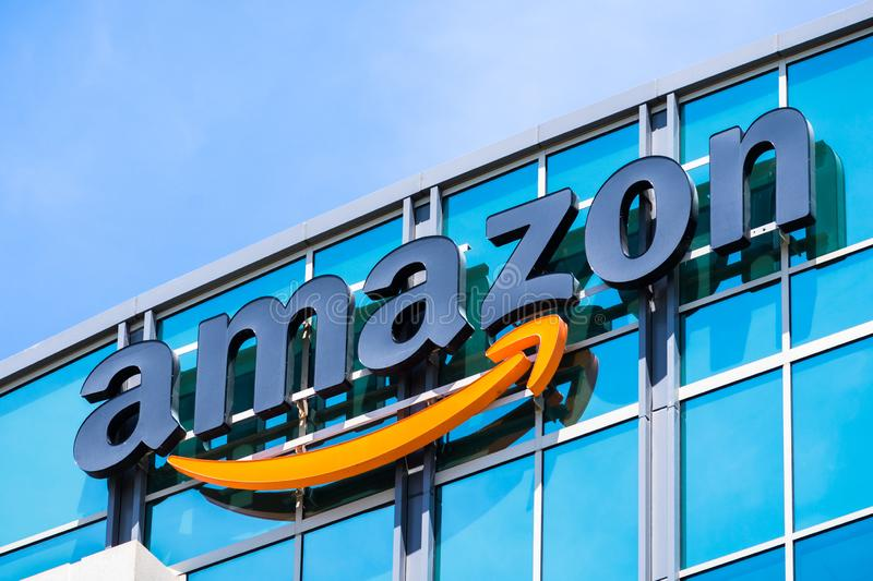 Amazon logo on the facade of one of their office buildings. May 3, 2018 Sunnyvale / CA / USA - Amazon logo on the facade of one of their office buildings located royalty free stock photo