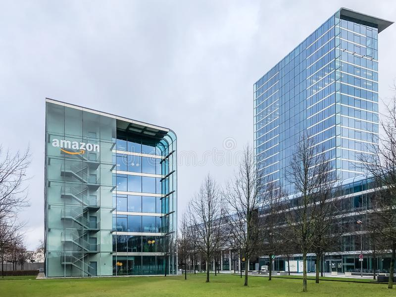 Amazon logo at office building, Munich Germany. MUNICH, GERMANY - DECEMBER 24, 2018: Amazon logo at the company office building located in Munich, Germany royalty free stock photography