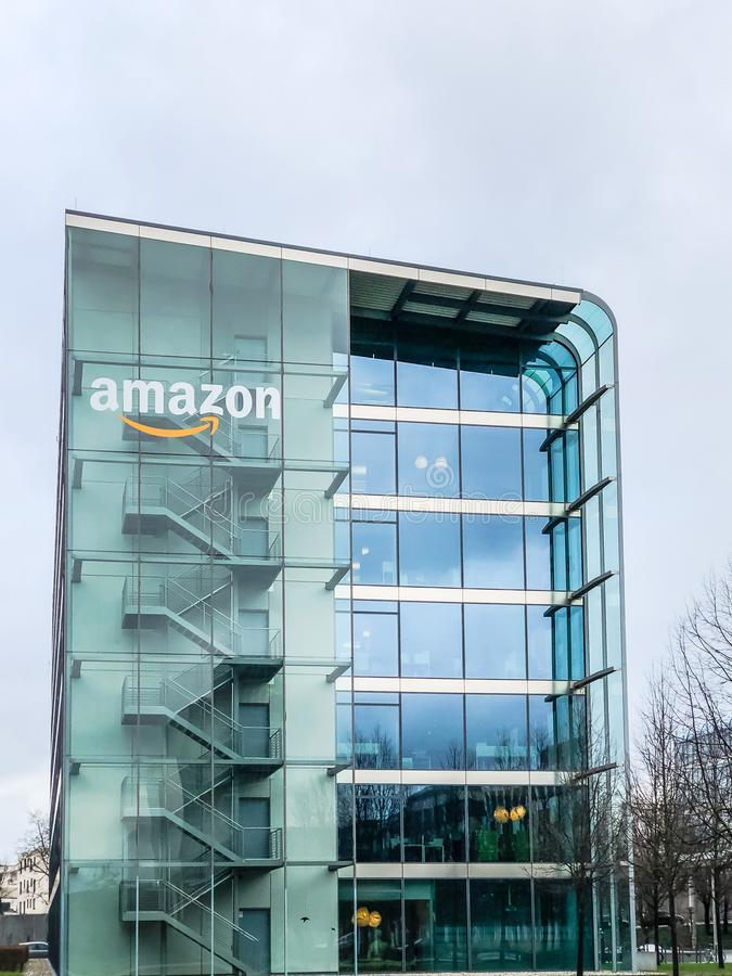Amazon logo at office building, Munich Germany. MUNICH, GERMANY - DECEMBER 24, 2018: Amazon logo at the company office building located in Munich, Germany stock photos